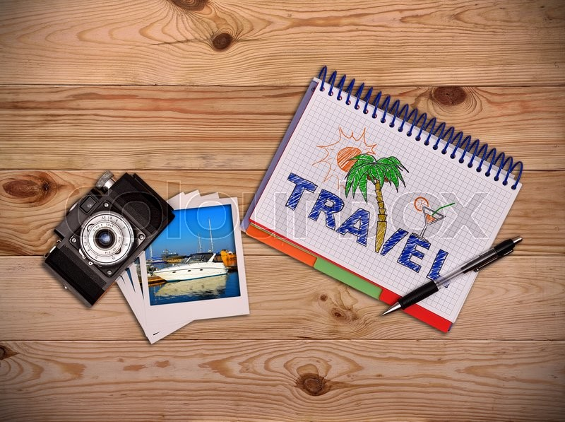 Stock image of 'Camera, photo and notepad with drawing beach holiday concept. Work desk tourist.'