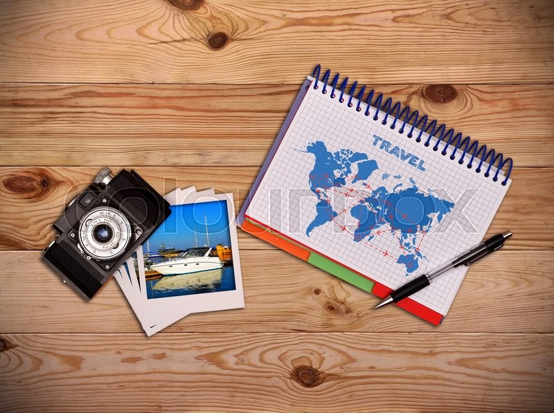 Stock image of 'Camera, photo and notepad with drawing air travel scheme. Work desk tourist.'
