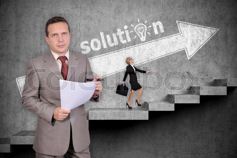 Stock image of 'Businessman with paper. Businesswoman with briefcase walking up on stairs. Drawing white arrow on wall. Solution concept'