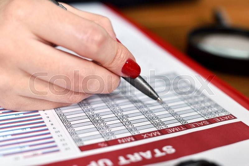 Stock image of 'businesswoman hand checks start up report. close up'