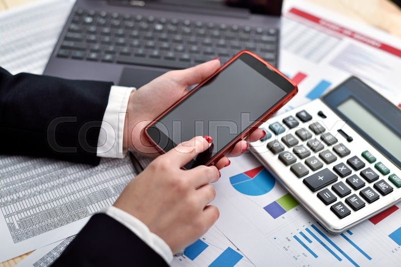 Stock image of 'businesswoman holding cellphone in hand. view from above'