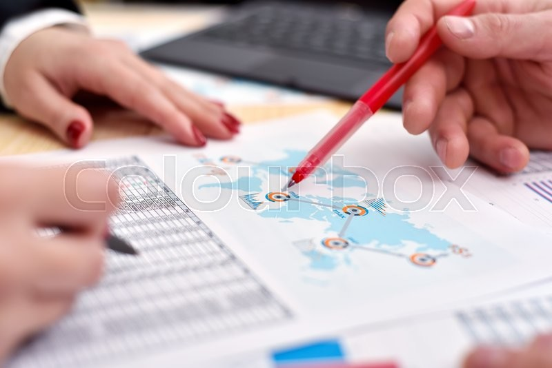 Stock image of 'Businessperson With Start up report And Pen In Office'