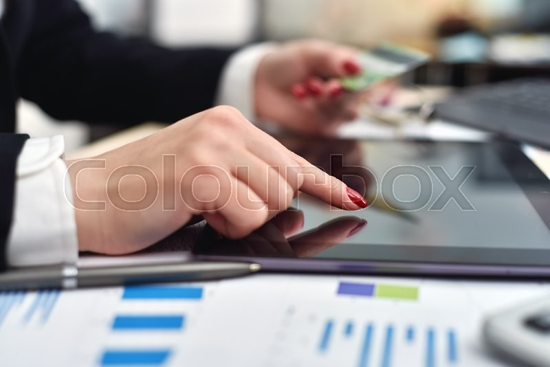 Stock image of 'businesswoman with a credit card to shop online'