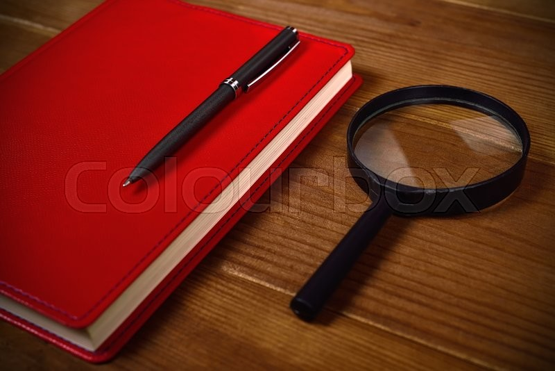 Stock image of 'Business accessories on desktop: notebook, pen and magnifier'