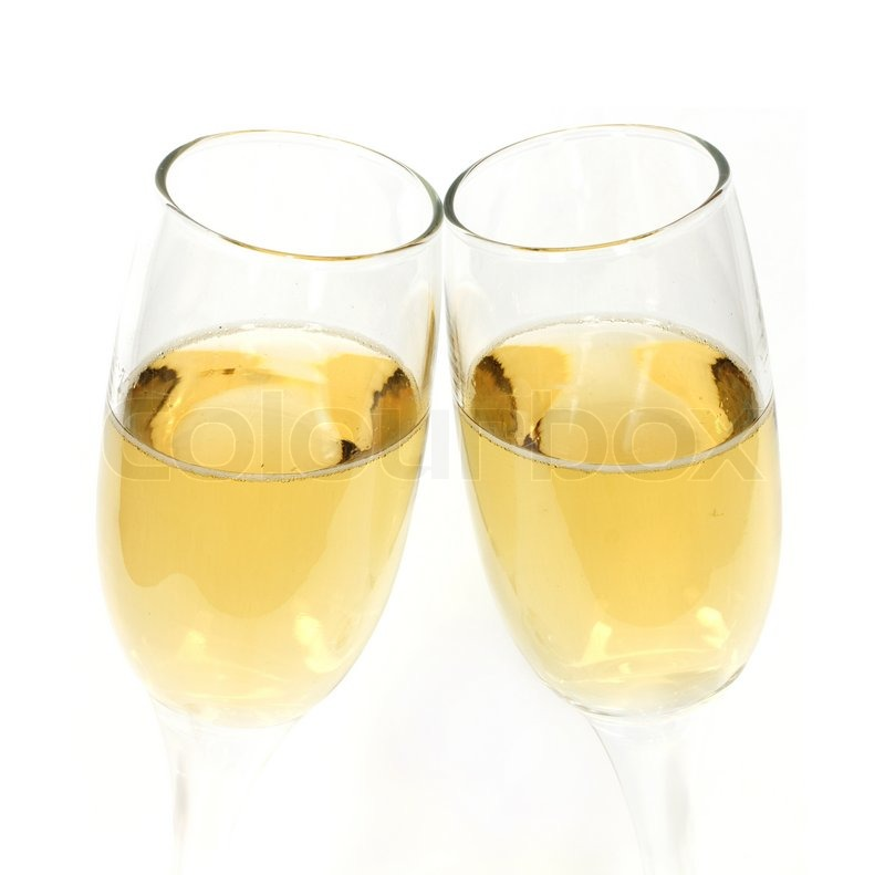 pair of champagne glasses making a toast stock photo colourbox