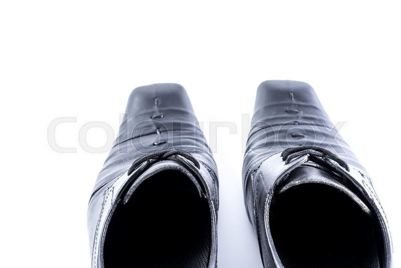 Stock image of 'Old Mens shoes on white background,selective focus.'