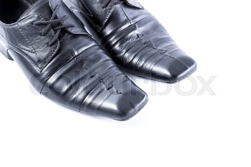 Stock image of 'Old Mens shoes on white background'