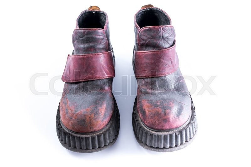 Stock image of 'Old vintage boots on white background'