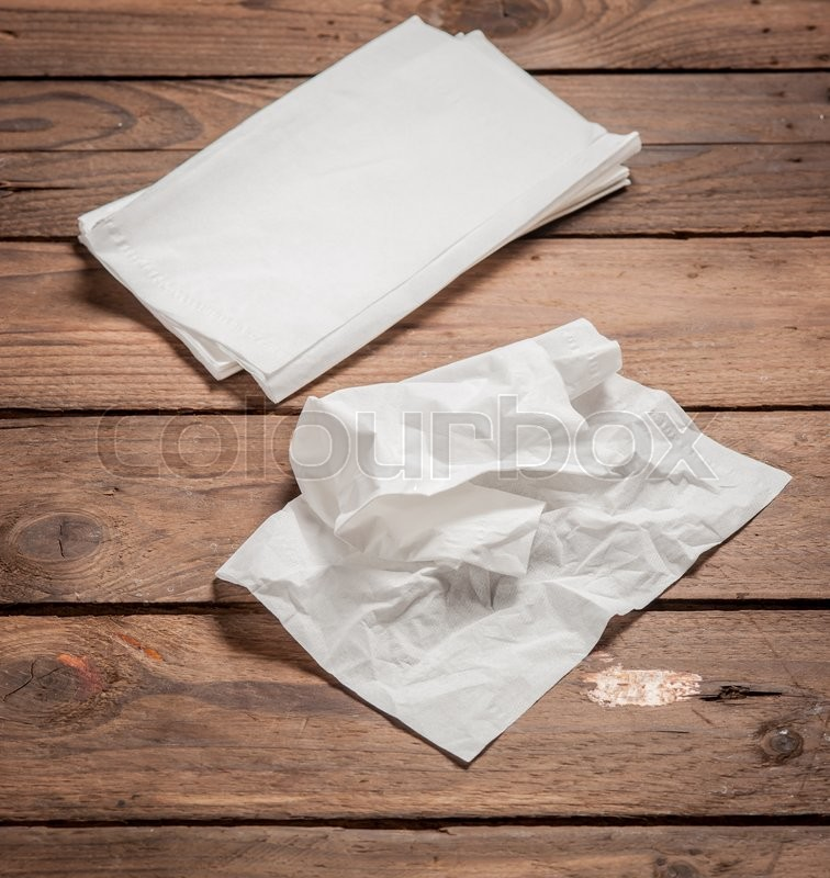 Stock image of 'White Paper Napkins on old wooden table.'