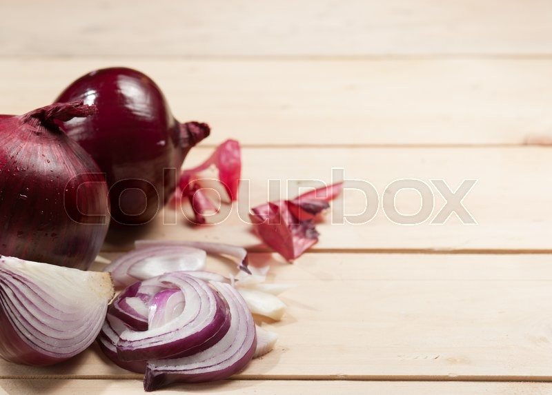 Stock image of 'Red onion on wooden background'