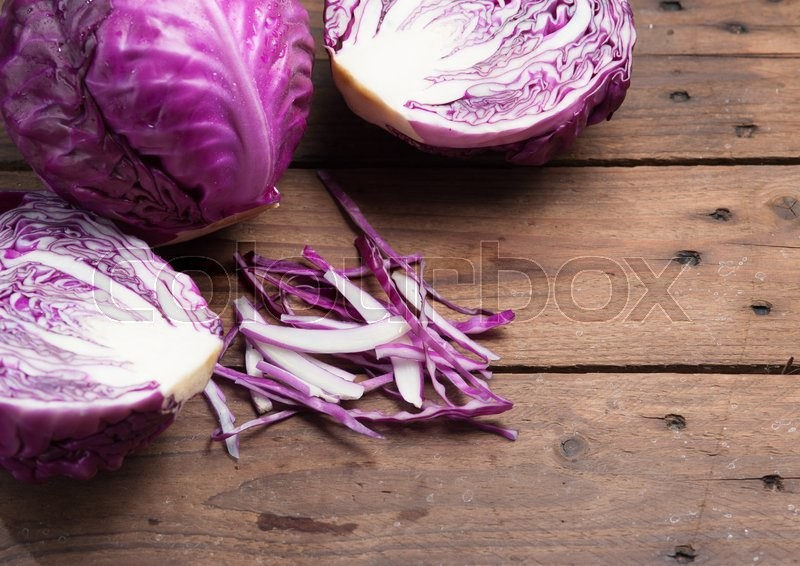 Stock image of 'Chopped Red Cabbage on Wooden Cutting Board'