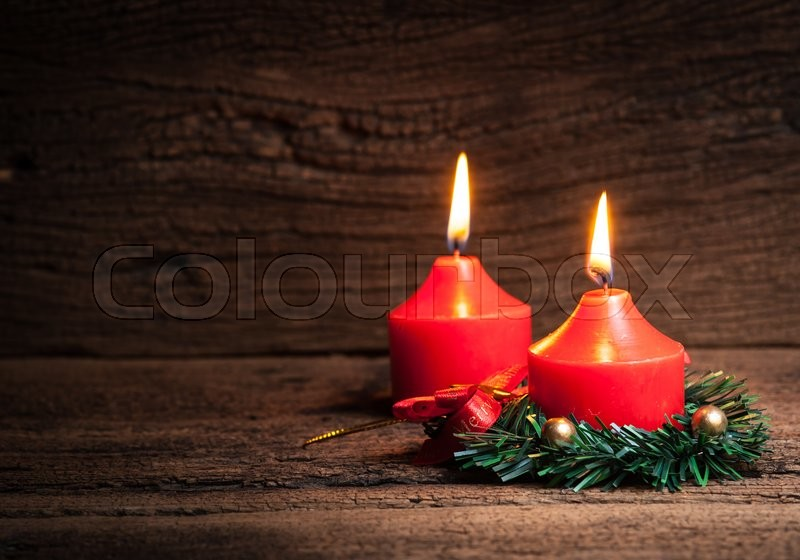 Stock image of 'Christmas candles and lights on wood background'