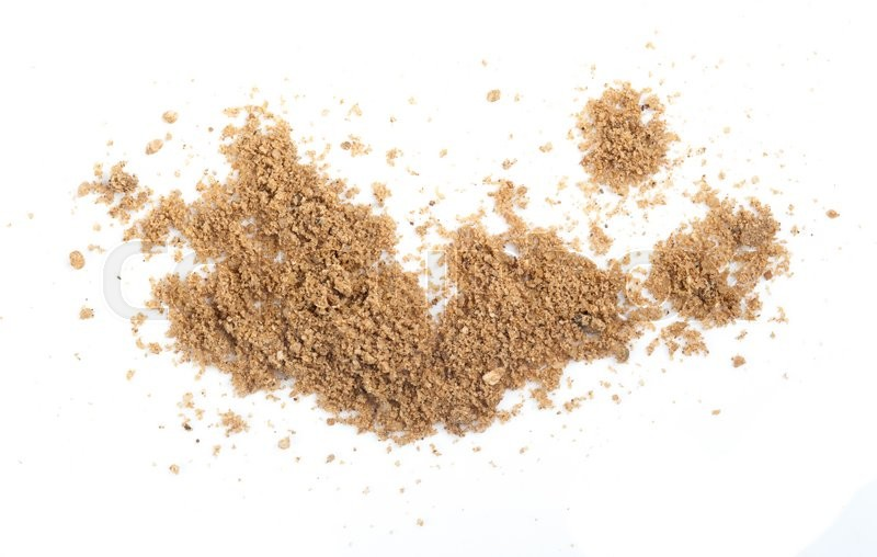 Stock image of 'Closeup of a pile of sand on a white background'