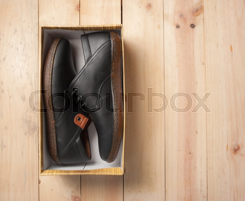 Stock image of 'Men's leather shoes on wood'