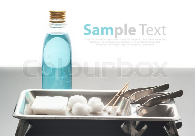Stock image of 'First aid kit for bandaging on glass ,white background'