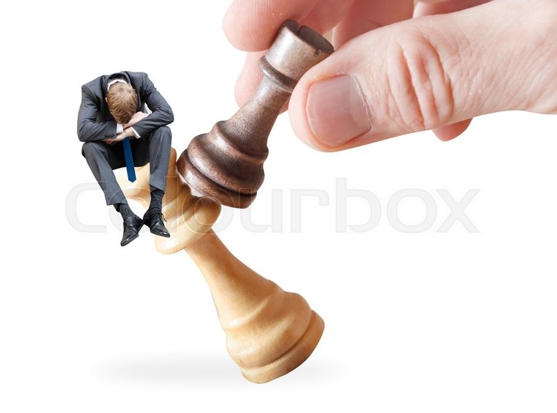 Stock image of 'A businessman on a chess piece'