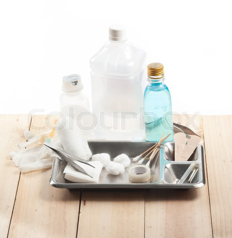 Stock image of 'First aid kit for bandaging on wood ,white background'