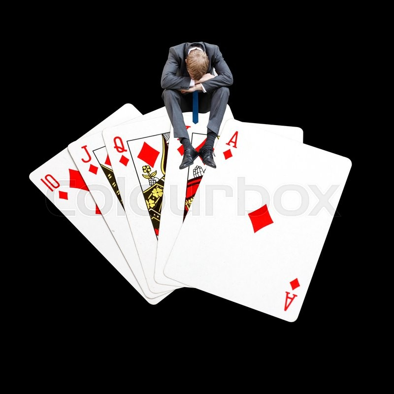 Stock image of 'Gambling on a perfect poker hand'