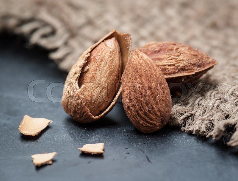 Stock image of 'Almonds on sack background,Selective focus'