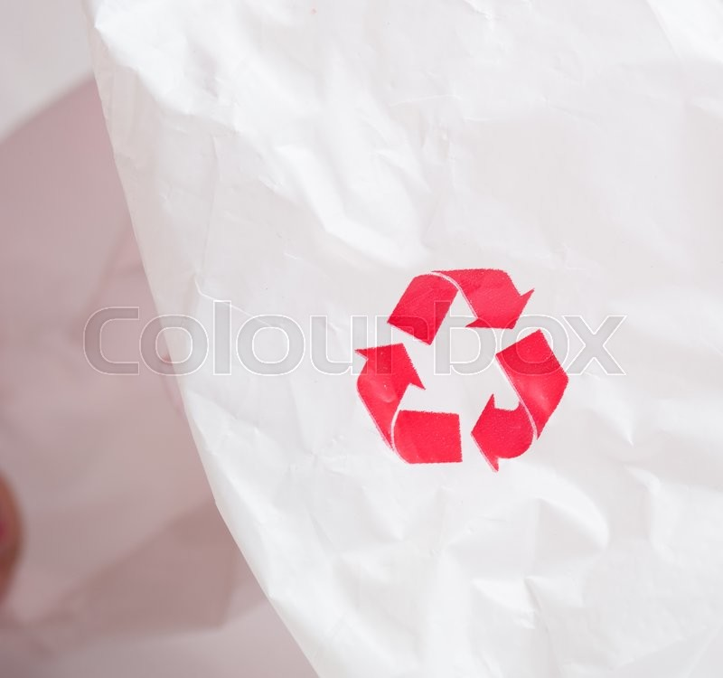 Stock image of 'Recycling logo on white plastic recycled'