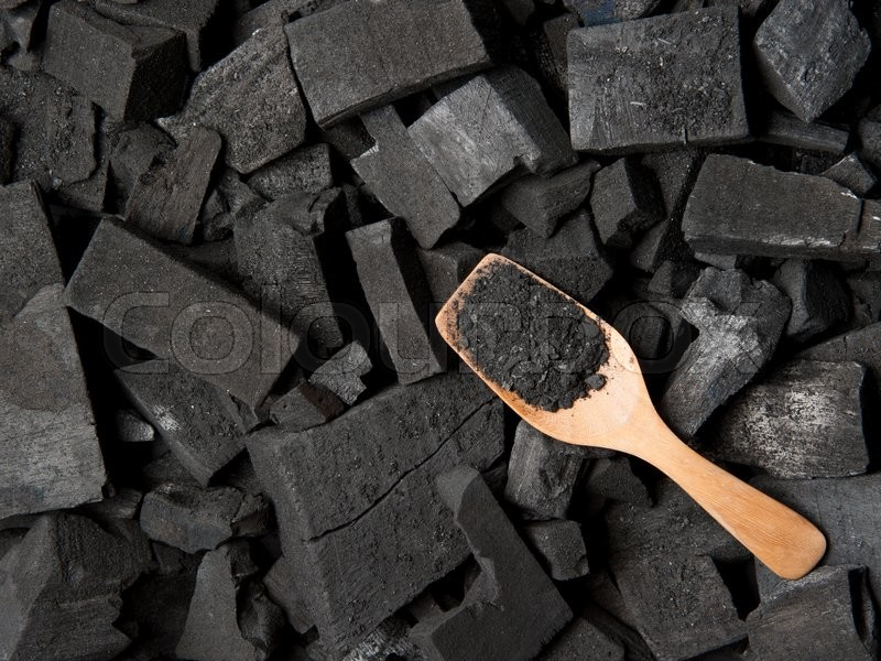 Stock image of 'Black particles charcoal'