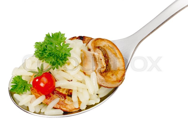 Stock image of 'Spoon with boiled rice (risotto) with mushrooms, currant tomato and parsley. Clipping path, infinite depth of field'