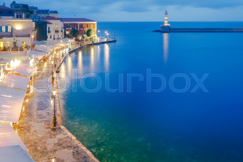 Stock image of 'Night view of the quay with lanterns and the old harbor in Chania. Greece.'