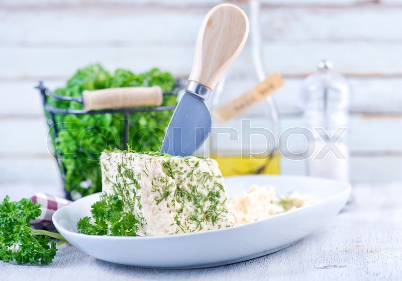 Stock image of 'cheese on plate and on a table'