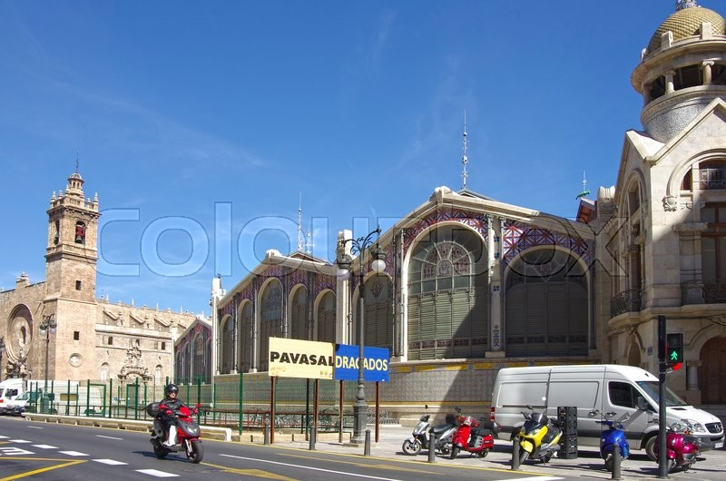 Editorial image of 'VALENCIA, SPAIN - OCTOBER 07, 2014: Santos Juanes church and Mercado Central in Valencia, Spain. Historic Mercado Central is one of the oldest markets in Europe'
