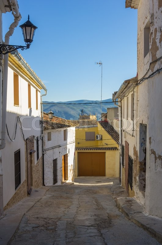 Stock image of 'Street with stone houses in little mountain village Montesa, province of Alicante, Spain'