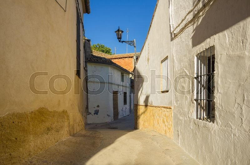 Stock image of 'Street with stone houses in Montesa, province of Alicante, Spain'