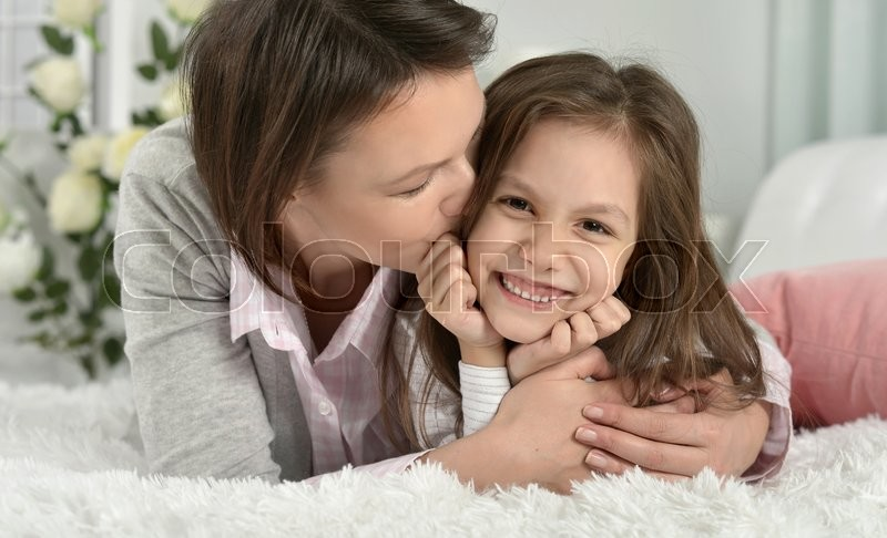 Stock image of 'Portrait of a happy mother with daughter  at home'
