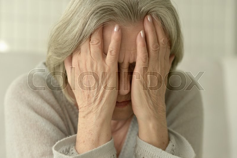Stock image of 'Portrait of a sad senior woman close up'