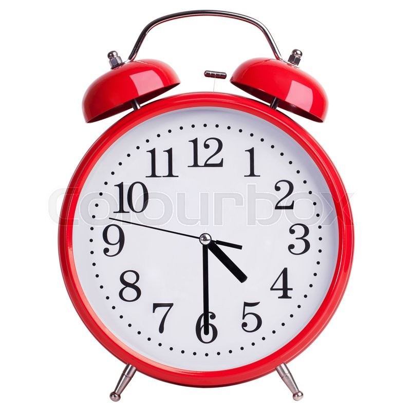 Stock image of 'Round red alarm clock shows half past four'