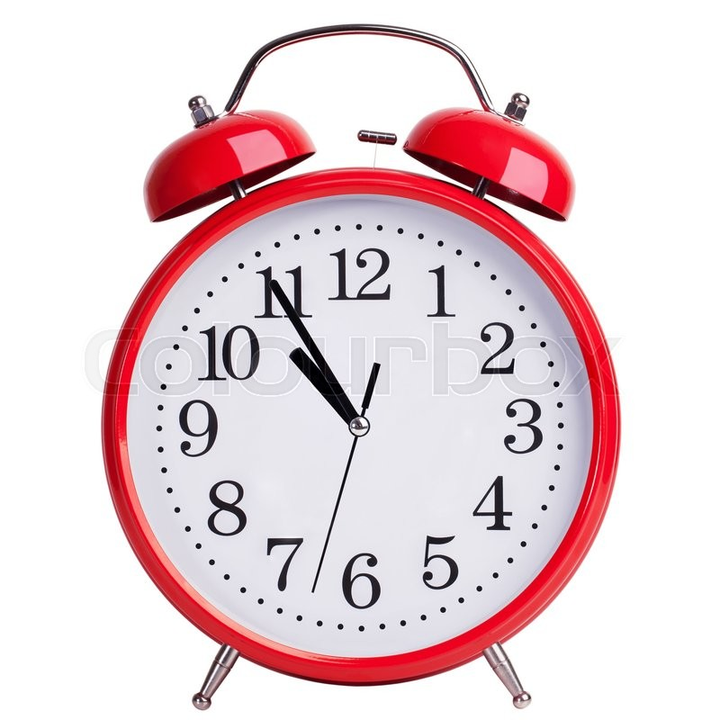 Stock image of 'Round red alarm clock is showing almost eleven'