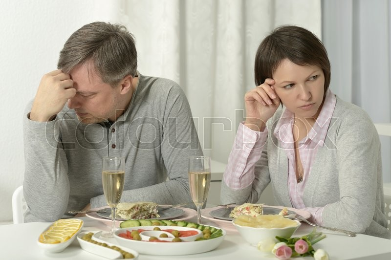 Stock image of 'Portrait of a unhappy couple have dinner  in a restaurant'