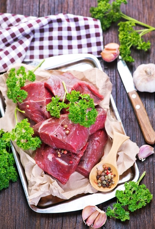 Stock image of 'raw meat with salt and spice on a table'