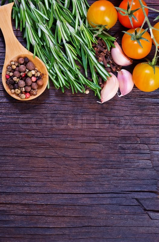 Stock image of 'mix pepper with fresh rosemary on a table'