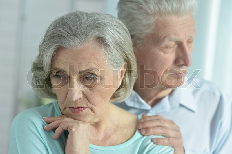 Stock image of 'Portrait of a melancholy senior couple close up'