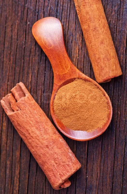Stock image of 'cinnamon in spoon and on a table'