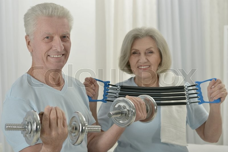 Stock image of 'Portrait of a happy sporty senior couple exercising'