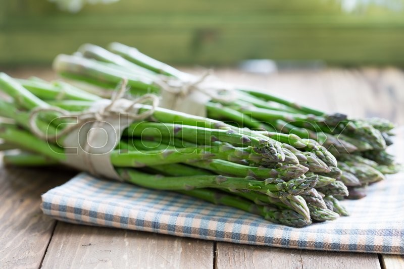 Stock image of 'Two bunches of asparagus green asparagus'