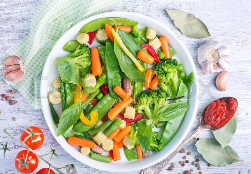 Stock image of 'mix vegetables in bowl and on a table'