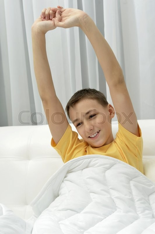 Stock image of 'Portrait of a cute waking up boy'