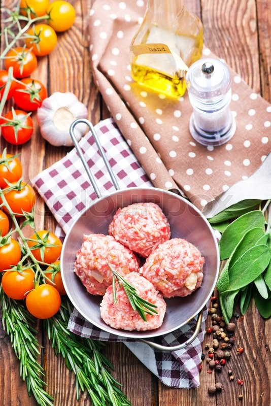 Stock image of 'meat balls in bowl and on a table'