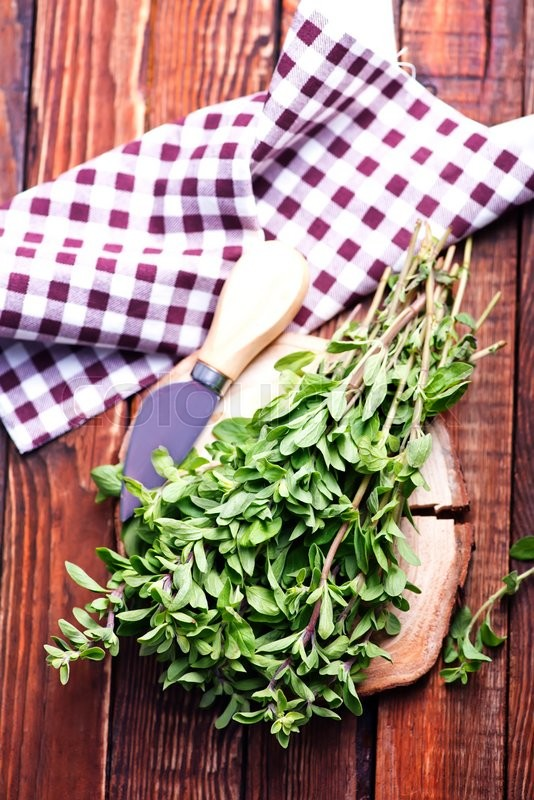 Stock image of 'fresh aroma herb,marjoram on a wooden rustic table'