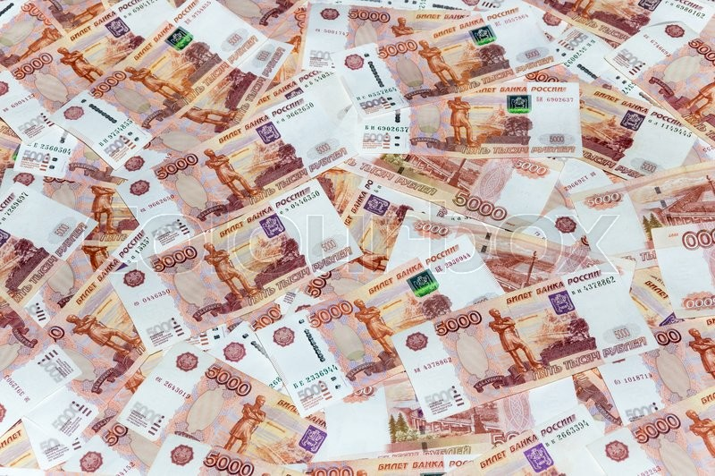 Stock image of 'Scattered ruble currency banknotes, closeup view'