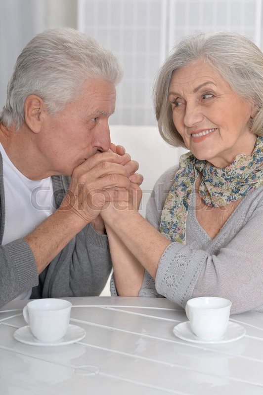 Stock image of 'Portrait of a happy Senior couple drinking tea'