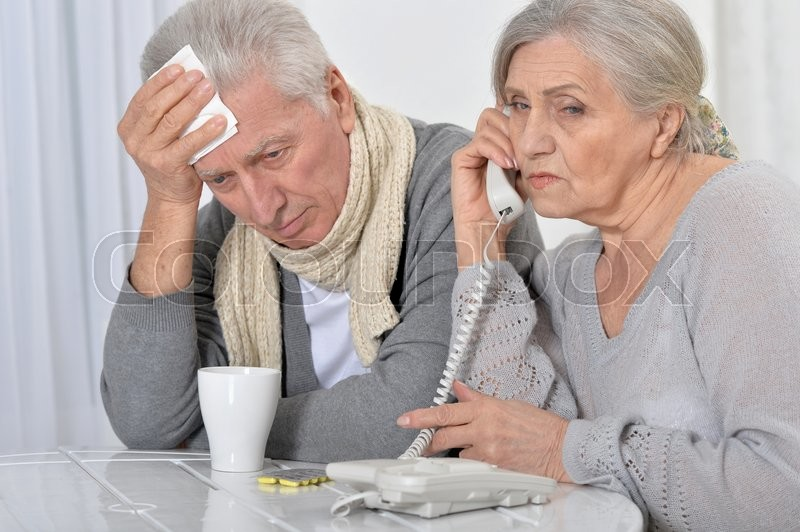 Stock image of 'ill Senior man and caring wife calling phone'