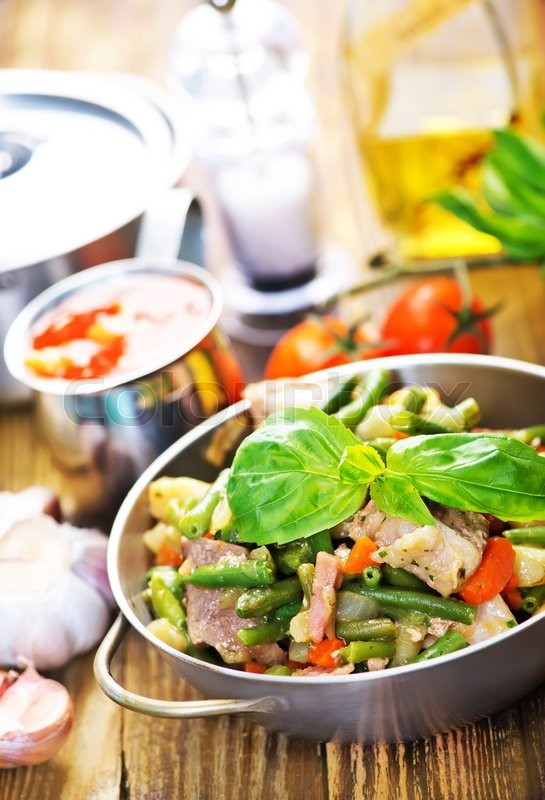 Stock image of 'fried meat with vegetables wirh spice and salt'